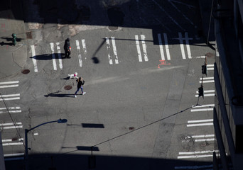 A woman runs with her dog on the street during the outbreak of coronavirus disease (COVID-19), shown in this aerial photo over Seattle