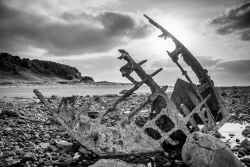 Acrylic Prints Shipwreck Rusty Ship Wreck on stone beach, New Plymouth, New Zealand