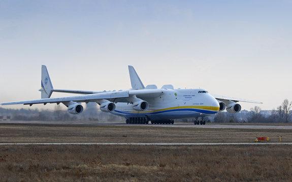 "KYIV, UKRAINE - APRIL 3, 2018: Ukrainian Antonov An-225 ""Mriya"" aircraft takes off from the Gostomel airport in Kyiv, Ukraine. The giant An-225 cargo plane is the heaviest aircraft ever built"