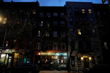 Night falls on McSorley's Old Ale House, which, established in 1854, is referred to as New York City's oldest Irish saloon and was ordered to close at 8:00pm as part of a city-wide order to close bars and restaurants