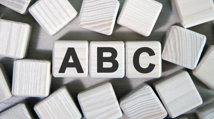 ABC - text on wooden cubes and many cubes around