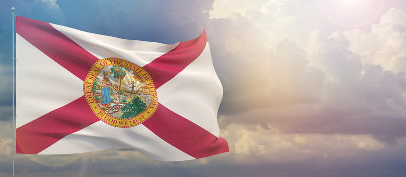 Flags of the states of USA. State of Florida flag. Waving flag on sunset sky background 3D illustration.
