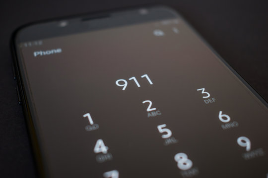 Close up smartphone calling 911 emergency services number
