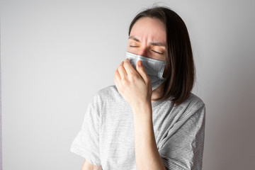 Girl in a medical mask. Medical mask for protection against viruses. Protection of the health of the patient and others. Prevention of the disease. Wall mural
