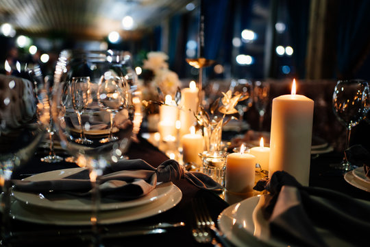festive table setting candles for wedding party