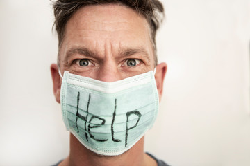 Portrait of a caucasian man in medical mask with stop text. Coronavirus concept