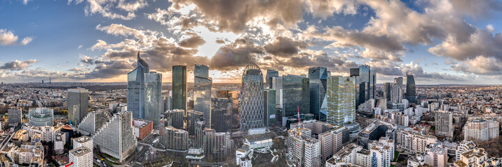Aerial panoramic drone shot of La defense skyscraper in Paris with clouds and sunset Fotobehang