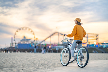 Young woman with a bike outdoors