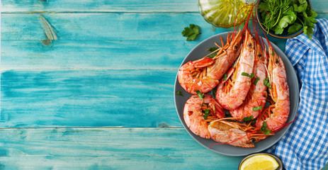 Top view of argentinian red prawns on aqua menthe background