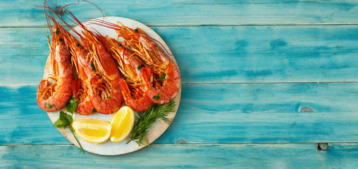 Top view of red big prawns on light blue background