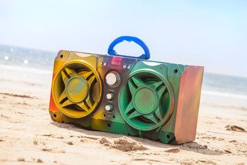 Wall Murals Palm tree Boom box multi coloured in spray paint on beach background