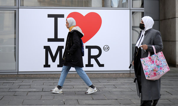 A woman wearing a protective face mask in Manchester as the number of coronavirus cases grow around the world.