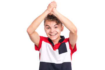 Fototapete - Portrait of teen boy happy and excited expressing winning gesture. Successful and celebrating victory, triumphant child making win sign. Beautiful caucasian teenager, isolated on white background.