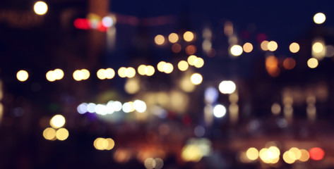 Fototapete - abstract background of colorful blurred defocused bokeh street lights. motion and nightlife concept
