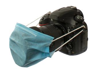 macchina fotografica con mascherina verde
