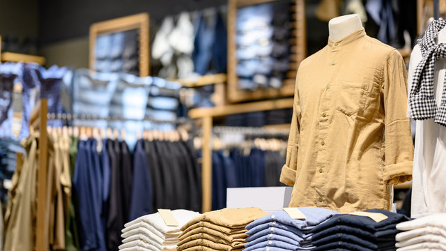 Trendy cotton Men shirt display on mannequin in clothes shop. Summer collection fashion product samples in clothing store for selling. Textile industry and business concept