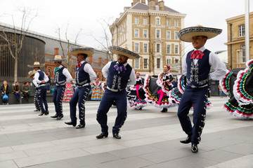 Dancers of the Smacht dance academy from the Mexican state of Chihuahua perform in front of Kings Cross Station, as the number of coronavirus cases grow around the world