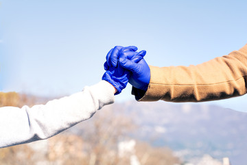 Man and child holding hands wearing medical gloves protection from Coronavirus