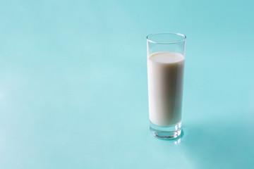 glass of milk on light blue background