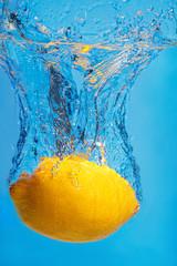 Fresh lemon drops in water with a splash