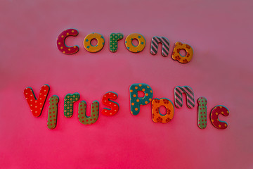 Corona virus panic written bei colored letters as symbol for the global covid-19 fear within pantone background color.