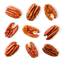 Peeled pecan nuts close-up on a white. Isolated