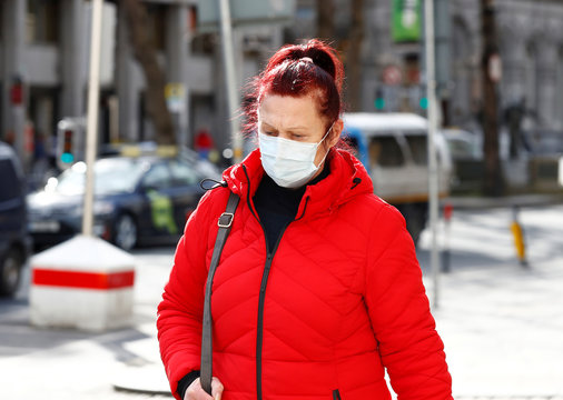 A woman wearing a face mask on St. Patrick's Day as public events were cancelled due to the number of coronavirus cases grow around the world