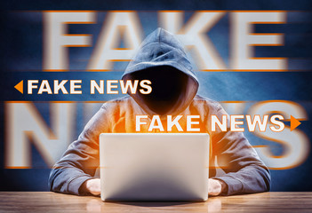hacker spreading fake news from a computer