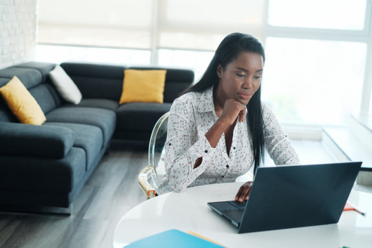 Black Woman Working From Home With Laptop Computer