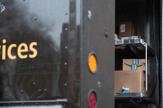 An Amazon package sits on a delivery truck in New York