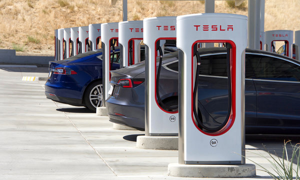 Kettleman City, CA - Sept 28, 2019: Tesla Super Charging station in Kettleman City off the 5 freeway. Supercharger stations allow Tesla cars to be fast-charged at the network within an hour.