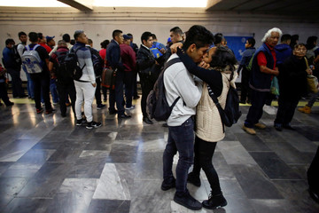 A couple kiss in the Pantitlan metro station as Mexico's government is seeking to minimize public disruption in its response to the coronavirus disease (COVID-19), in Mexico City