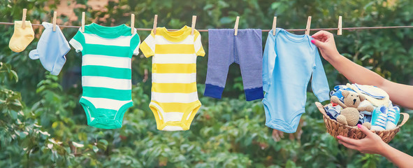 washing baby clothes. Linen dries in the fresh air. Selective focus. Wall mural