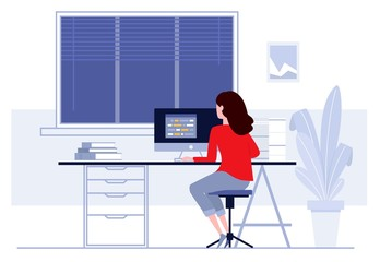 Woman sitting at table and working at home.