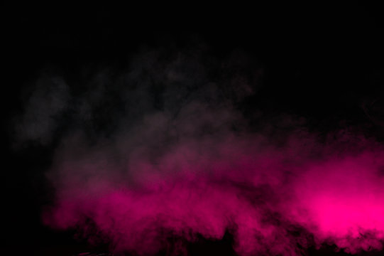 Pink smoke isolated on black background