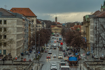 Cars driving at a road, much traffic in Munich at the Prinzregentenstrasse in the bavarian capital.