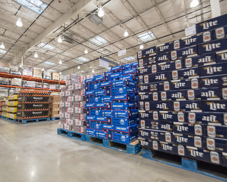 Domestic beers on display in stack of large cardboard boxes at Costco Wholesale