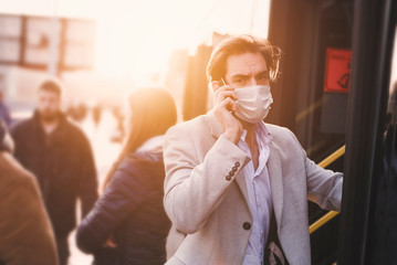 A man is late for a meeting, wearing a surgical mask, hurry up to catch the bus