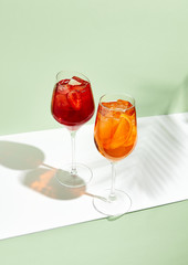 Red and orange summer cocktail on creative background