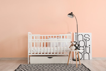 Baby bed near wall in interior of children's room