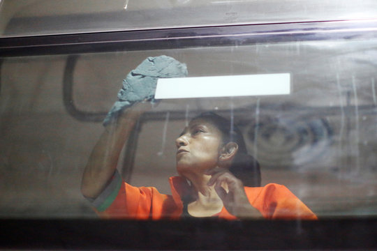 A worker cleans the windows of a metro car before a disinfection, as part of Mexico City's government's measures in response to the coronavirus disease (COVID-19), in Mexico City