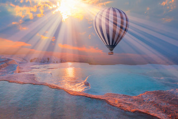 Hot air balloon flying over spectacular pamukkale - Natural travertine pools and terraces in Pamukkale. Cotton castle in southwestern Turkey, Fotobehang