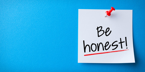 White Sticky Note With Be Honest And Red Push Pin On Blue Background
