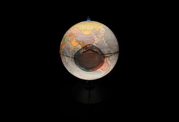 A protective mask is pictured on a table world globe in this illustration