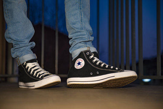 Young man wearing brand new Converse Chuck Taylor