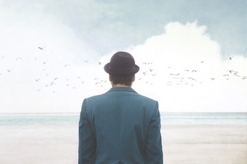 man in blue suite and bowler observing seagulls over the sea, surreal abstract concept Wall mural