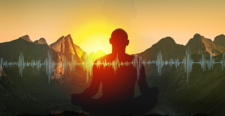 Yoga meditation illustration, silhouette of man practicing in mountains at sunset Fototapete