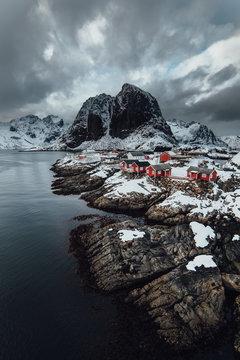 Red cabins on coastline of Hamnoy village