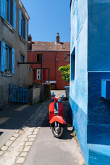 Fotorollo Scooter little colorful alley with vintage scooter in Reze Trentemoult village France
