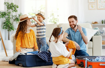 Playful family packing for holiday at home Fotomurales